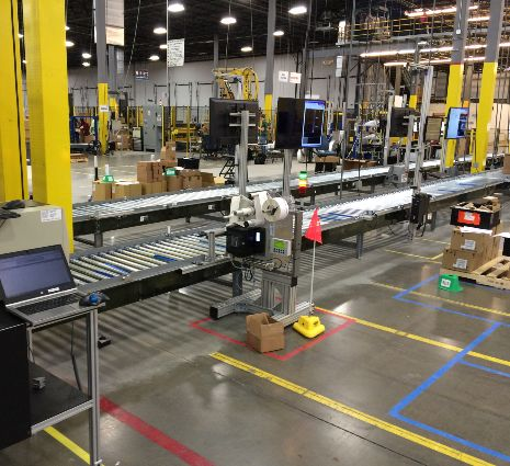 Conveyor Weigh Scale for Order Fulfillment - MMCI Robotics, robotic palletizer, robotic palletization, robotic palletizing system, robotic palletizers, robotic palletizing arm, palletizier, automatic palletizer, palletization